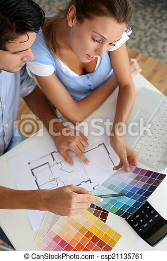 Upper view of couple looking at colour chart - csp21135761