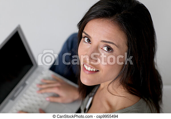 Upper view of woman using laptop computer - csp9955494