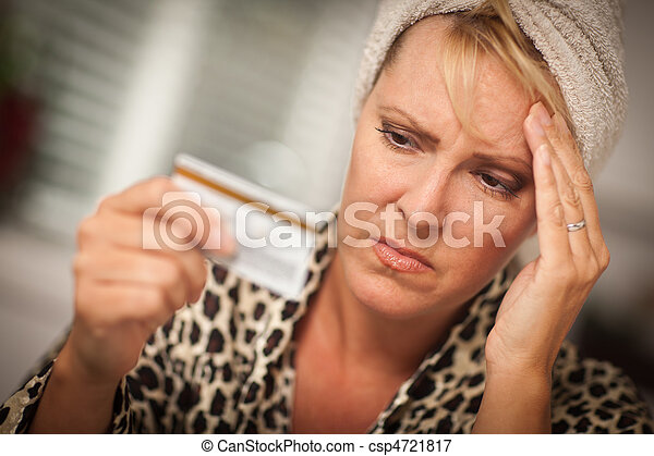 Upset Woman Holding Her Credit Card - csp4721817