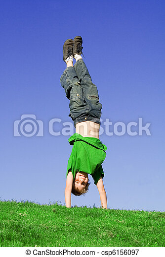 upside down child playing outdoors in summer - csp6156097