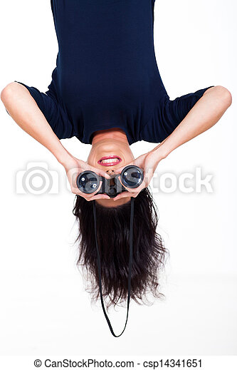 upside down woman holding binoculars - csp14341651