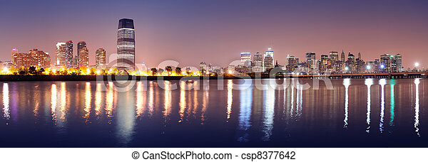 Urban city night panorama - csp8377642