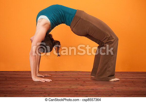 urdhva dhanurasana yoga pose young woman performs upward