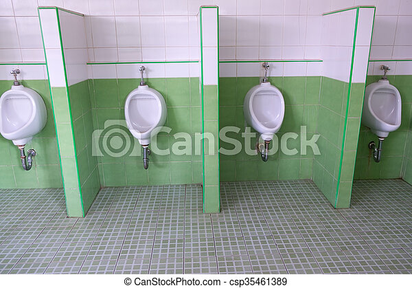 urinals in an old building for men only - csp35461389