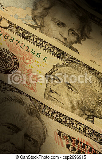 U.S. banknotes of various dollar denominations ($20, $50 and $100), visually focusing on the featured historical figures: Alexander Hamilton, Ulysses S. Grant and Andrew Jackson - csp2696915