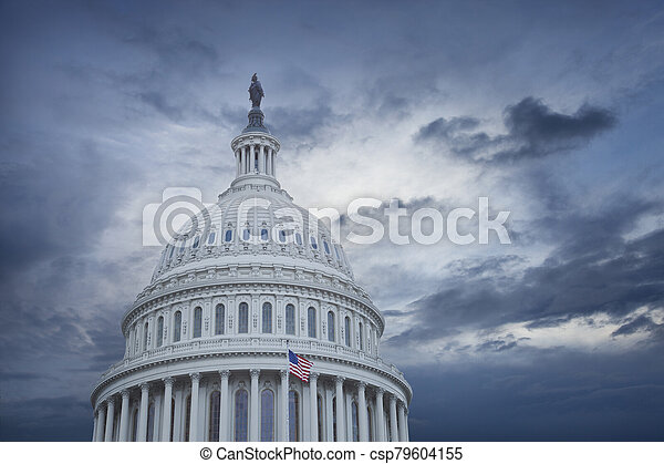 US Capitol dome under stormy skies - csp79604155
