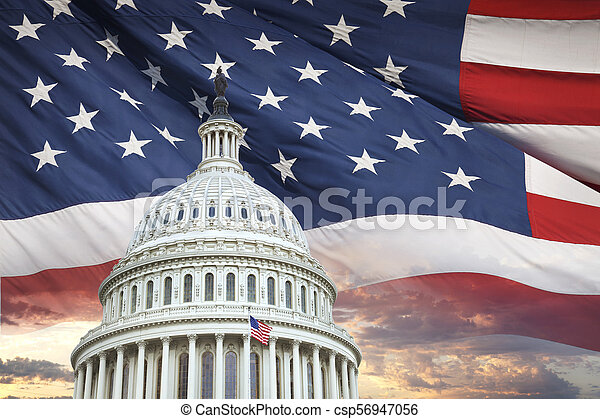 US Capitol dome with American flag and dramatic sky behind - csp56947056