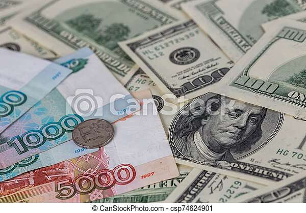 us dollars and russian rubles close-up background with selective focus - csp74624901