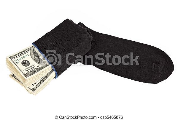 US dollars bundle hidden in black sock  - csp5465876