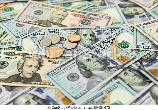 US dollars  pattern background of 5, 10, 20, 50 and 100 dollar bills. - csp89434472