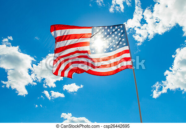 US flag and cumulus clouds on background