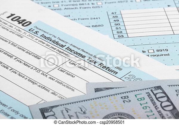 Us Tax Form 1040 With 100 Us Dollar Bills Tax Form 1040 Stock