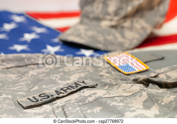 USA army uniform lying over national flag - studio shot - csp27768972 843cdce2eea