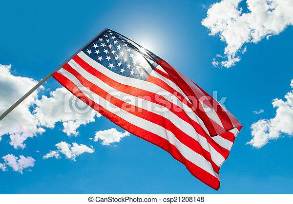 USA flag waving on blue sky background - csp21208148