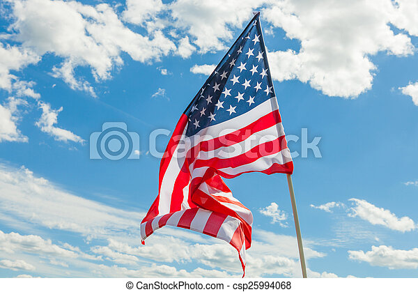 USA flag with clouds on background - outdoors shoot - csp25994068