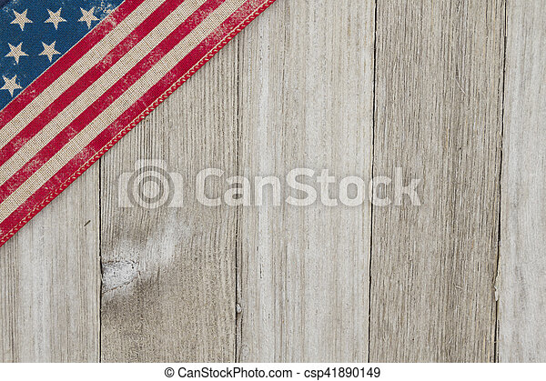 USA patriotic old flag on a weathered wood background - csp41890149