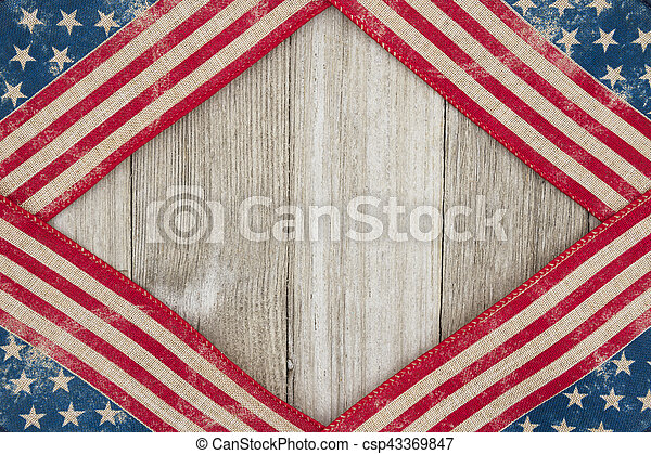 USA patriotic old flag on a weathered wood background - csp43369847