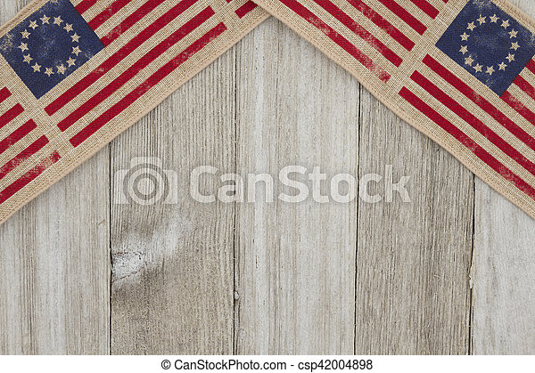 USA patriotic old flag on a weathered wood background - csp42004898