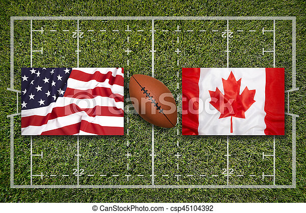 USA vs. Canada flags on green rugby field
