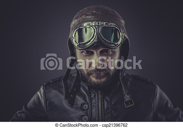 usaf pilot dressed in vintage style leather cap and goggles - csp21396762