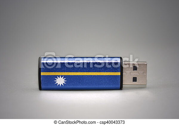 usb flash drive with the national flag of Nauru on gray background. - csp40043373