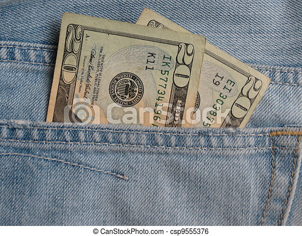 USD notes in blue jeans pocket - csp9555376
