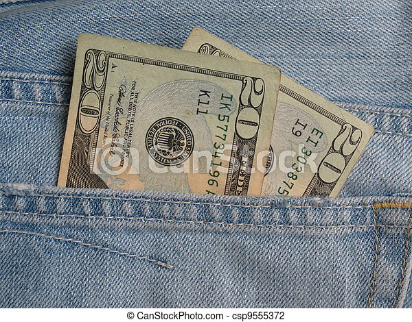 USD notes in blue jeans pocket - csp9555372