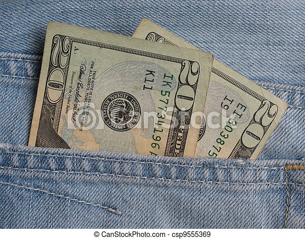 USD notes in blue jeans pocket - csp9555369