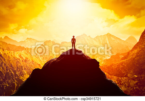 usinessman in hat on the peak of the mountain. Business venture, future perspective, success - csp34915721