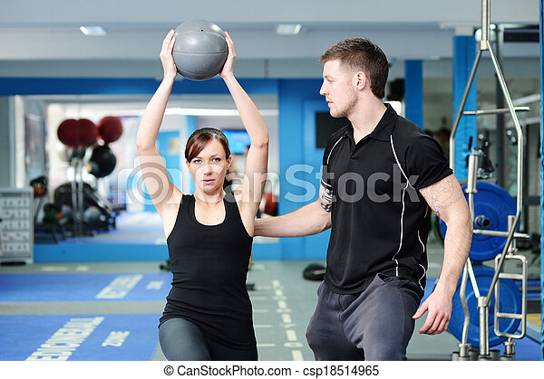 Using medicine ball with personal trainer - csp18514965