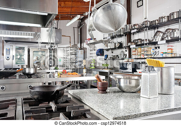 Utensils On Counter In Commercial Kitchen - csp12974518
