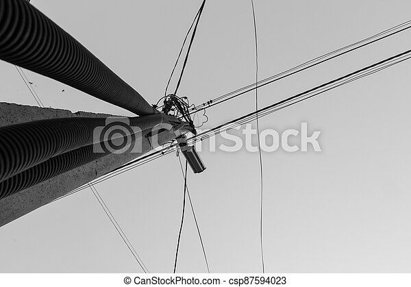 Utility pole with electrical wires - csp87594023
