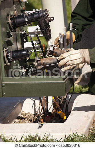 Utility Workers Installing New Electrical Equipment - csp3830816