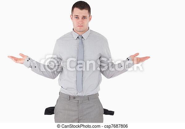 Hombre de negocios con bolsillos vacíos - csp7687806