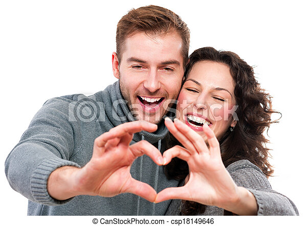 Valentine Couple Making Shape of Heart by their Hands - csp18149646