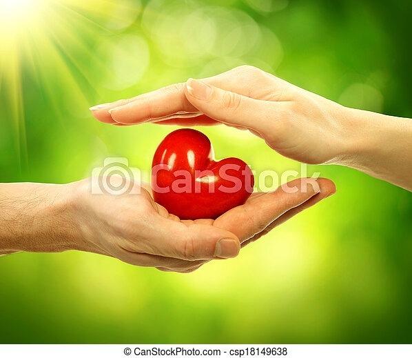Valentine Heart in Man and Woman Hands over Nature Background - csp18149638