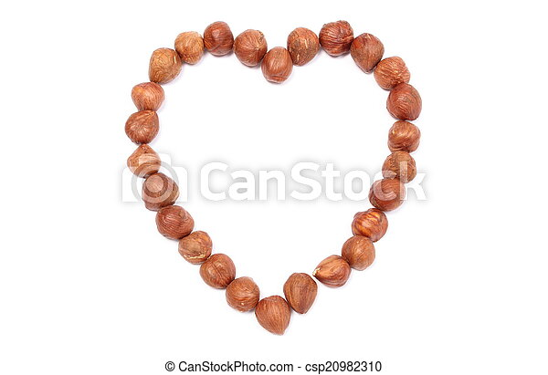 Valentine heart of hazelnut on white background - csp20982310