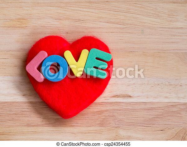 Valentines Day background red heart on wooden background - csp24354455