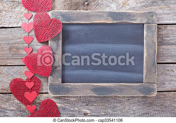 Valentines day decorations around a chalkboard - csp33541106
