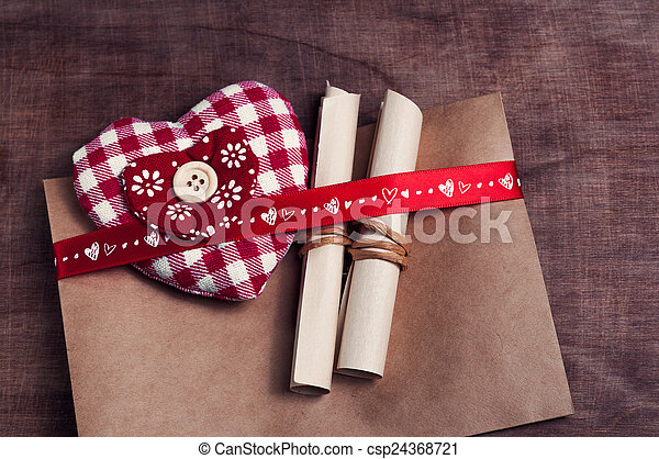 Valentine's day. Envelope with red hearts on Brown wooden background. - csp24368721