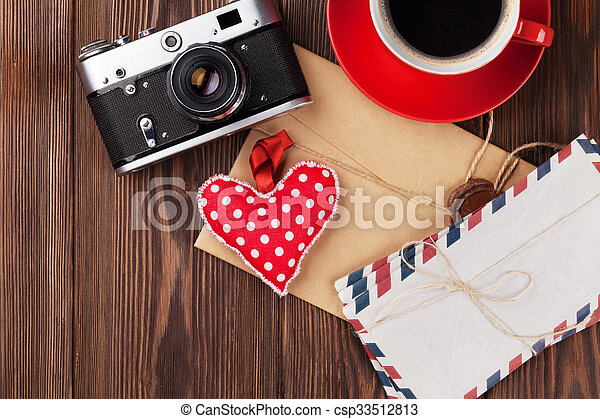 Valentines day heart, camera, coffee and letters - csp33512813