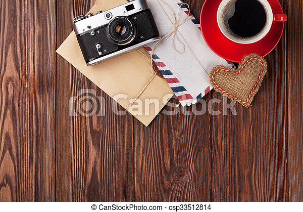 Valentines day heart, camera, coffee and letters - csp33512814