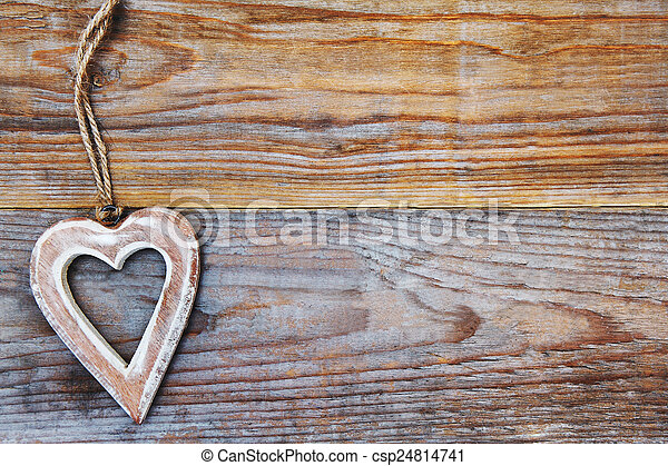 Valentines Day - heart on wooden background - love symbol - csp24814741