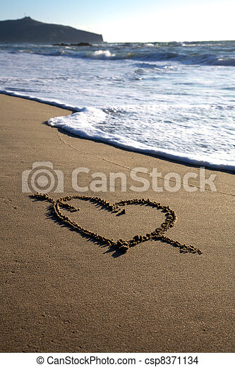 Valentine's Day heart with cross on the beach - csp8371134