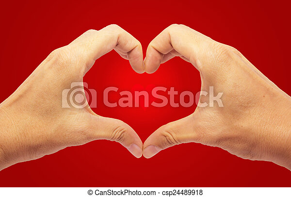 Valentines Day - Making Heart with 2 Hands on Red Background  - csp24489918