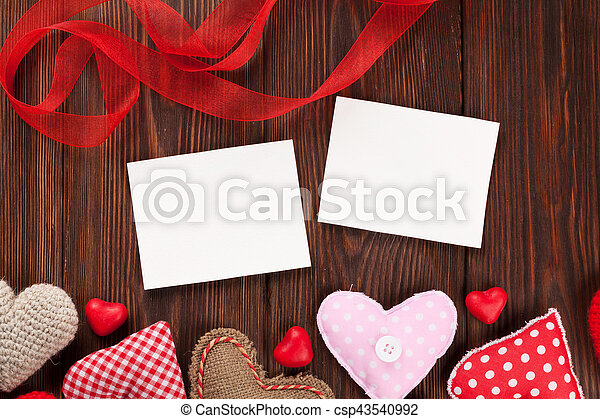 Valentines Day Photo Frames And Candy Hearts Over Wooden Table Top