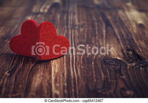Valentines day red hearts on old wood background. - csp65412467