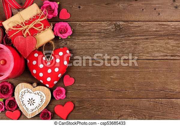 Valentines Day Side Border Of Hearts Gifts Flowers And Decor On Rustic Wood