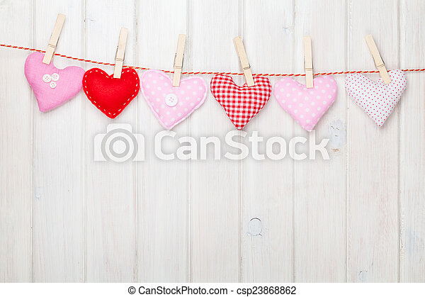 Valentines day toy hearts hanging on rope - csp23868862
