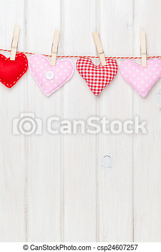 Valentines day toy hearts hanging on rope - csp24607257